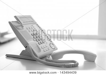 Modern office IP telephone set on light background