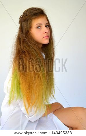 Girl with long hair dyed with colored strands Ombre