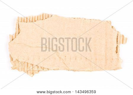 Brown corrugated cardboard torn and isolated on white.