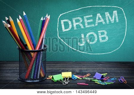 Dream Job text on green board and group of pencils