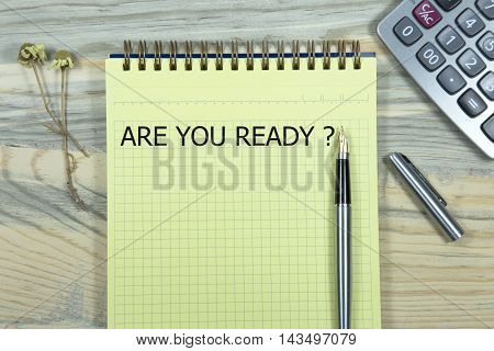 are you ready writing in notebook. pen and calculator wooden desk. business concept