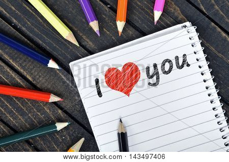 I love you on notepad and colorful pencils