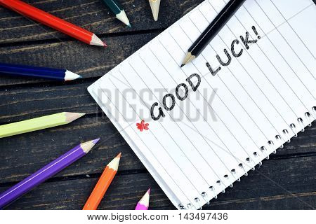 Good Luck text on notepad and colorful pencils