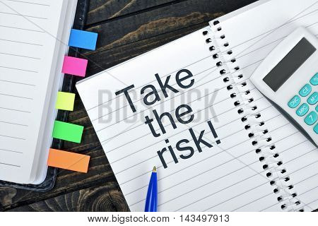 Take the risk text on notepad and hand calculator
