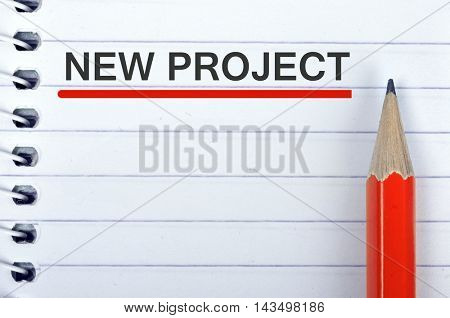 New Project text on notepad and red pencil