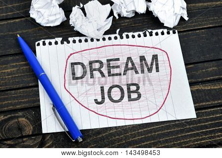 Dream Job text on notepad and crippled paper