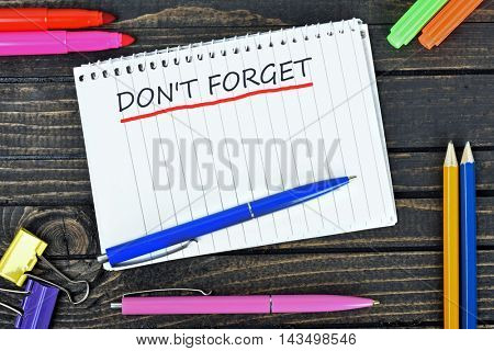 Don't forget text on notepad and office tools on wooden table