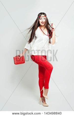 High Fashion Look. Glamour Stylish Beautiful Young Woman Model with Red Lips and Accessories