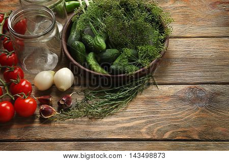 Preparation of vegetables for homemade preserving on wooden background