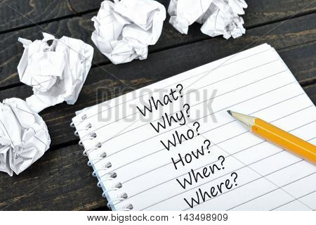 Questions text on notepad and crippled paper
