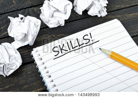 Skills text on notepad and crippled paper