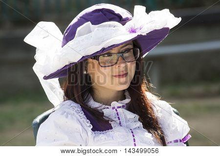 CAGLIARI, ITALY - June 1, 2014: Sunday at La Grande Jatte public gardens - Sardinia - portrait of a beautiful girl in Victorian costumes