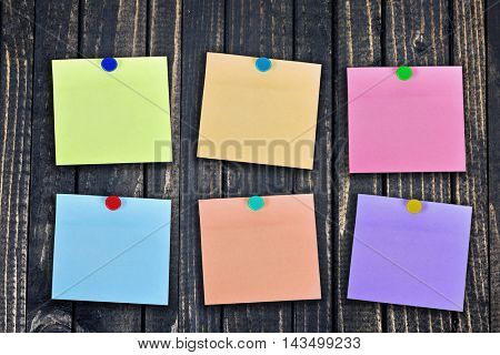 Many empty note on wooden wall