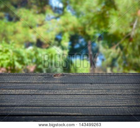 Empty wooden table in rural outdoor scene