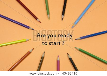 Colored Pen written showing to center with a word are you ready to start