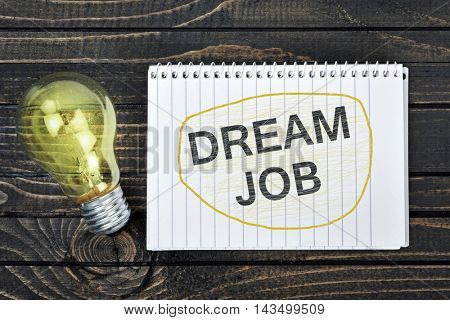 Dream Job text on notepad and light bulb