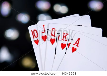 A royal flush, heart suit, with colored light background