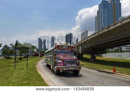 Panama City Panama - March 17 2014: Red Devil Bus (Diablo Rojo) in a street of Panama City. Red Devil buses are public transports painted in bright colors and symbols.