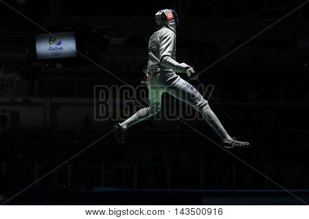 RIO DE JANEIRO, BRAZIL - AUGUST 12, 2016: Miles Chamley-Watson competes in the Men's team foil of the Rio 2016 Olympic Games at the Carioca Arena 3