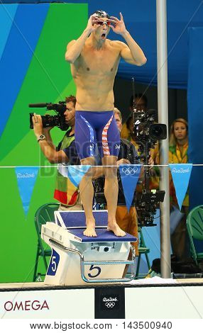 RIO DE JANEIRO, BRAZIL - AUGUST 13, 2016:Olympic champion Michael Phelps of United States before the Men's 4x100m medley relay of the Rio 2016 Olympic Games at the Olympic Aquatics Stadium