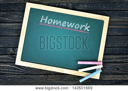 Homework text on school board and chalk