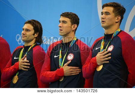 RIO DE JANEIRO, BRAZIL - AUGUST 13, 2016: USA Men's 4x100m medley relay team Ryan Murphy (L), Cory Miller,  Michael Phelps and Nathan Adrian celebrate victory at the Rio 2016 Olympic Games