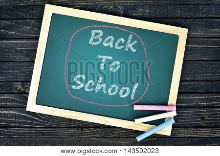 Back to school text on school board and chalk