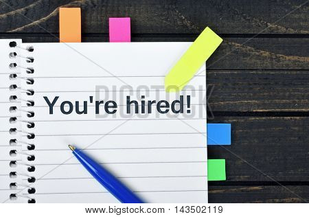 You're hired word on notepad and pen