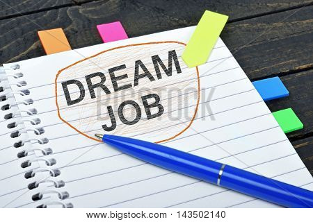 Dream job word on notepad and pen