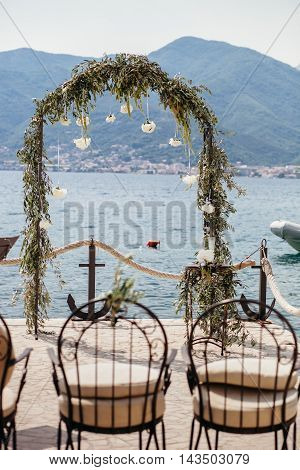Destination Wedding Arch With Flower Decoration And Sea View
