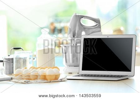 Laptop on kitchen table. Food blogger concept