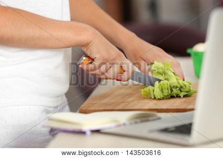 Girl cooking on kitchen. Food blogger concept