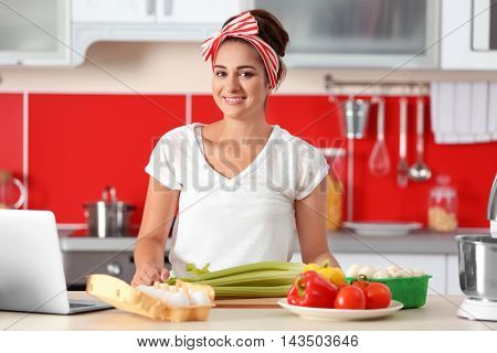 Beautiful girl cooking on kitchen. Food blogger concept