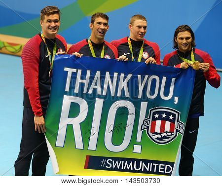 RIO DE JANEIRO, BRAZIL - AUGUST 13, 2016: USA Men's 4x100m medley relay team Nathan Adrian(L),  Michael Phelps, Ryan Murphy and Cory Miller celebrate victory at the Rio 2016 Olympic Games