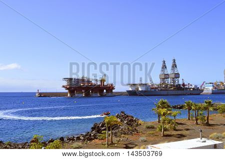 Santa Cruz De Tenerife port Tenerife Canary Islands Spain Europe - June 14 2016 : Ensco offshore drilling ships and Floatel Reliance platform in Santa Cruz De Tenerife port