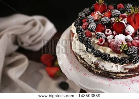 Appetizing cake decorated with berries