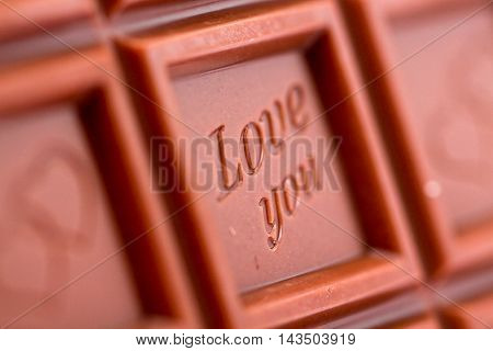 picture of a sweet chocolate pieces with love theme