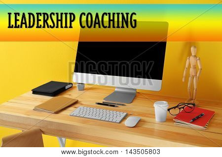 Working place on yellow wall background. Leadership coaching concept