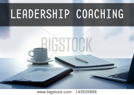 Workplace with tablet and documents. Leadership coaching concept