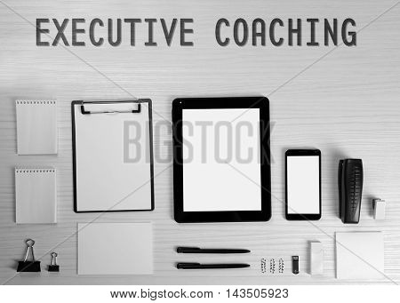 Office set on light wooden background. Executive coaching concept