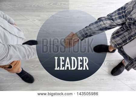 Business training concept. Men shaking hands in room, top view
