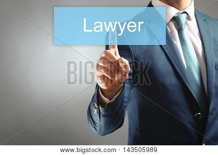 Businessman hand touching LAWYER tab on virtual screen