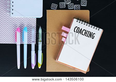 Office set with stationery and notebooks on a table. Coaching concept