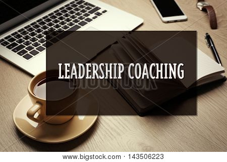 Office set on wooden table. Leadership coaching concept