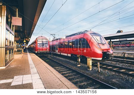 Beautiful Railway Station With Modern High Speed Red Commuter Trains