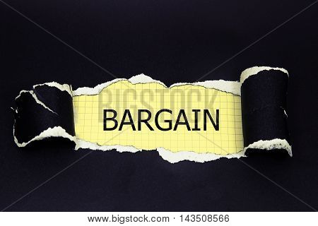 BARGAIN word written under black torn paper.