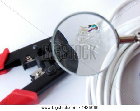 Cable, Cat5 & Cable Crimper Under A Magnifier