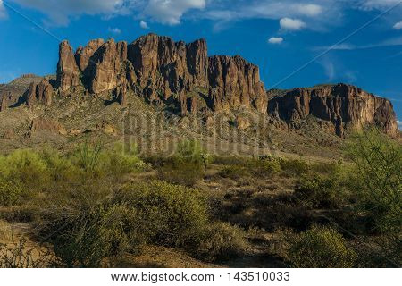 Sunset starts to approach the plains of the Superstition Mountains