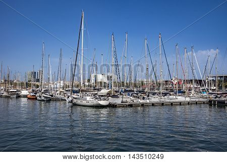 BARCELONA SPAIN - JULY 4 2016: Yachts and sailboats moored in the Port Vell of Barcelona Catalonia Spain