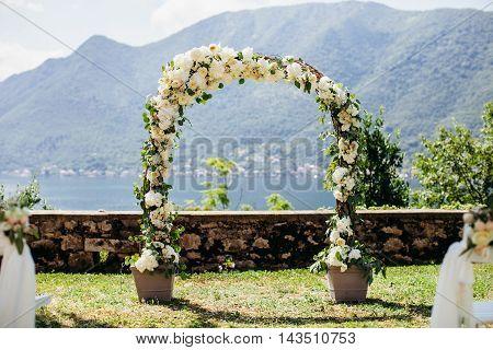 Destination Wedding Arch With Flower Decoration